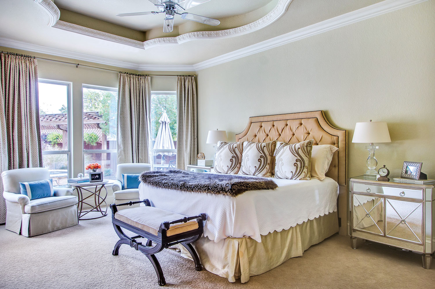 A photo of a bedroom with neutral and blue decor