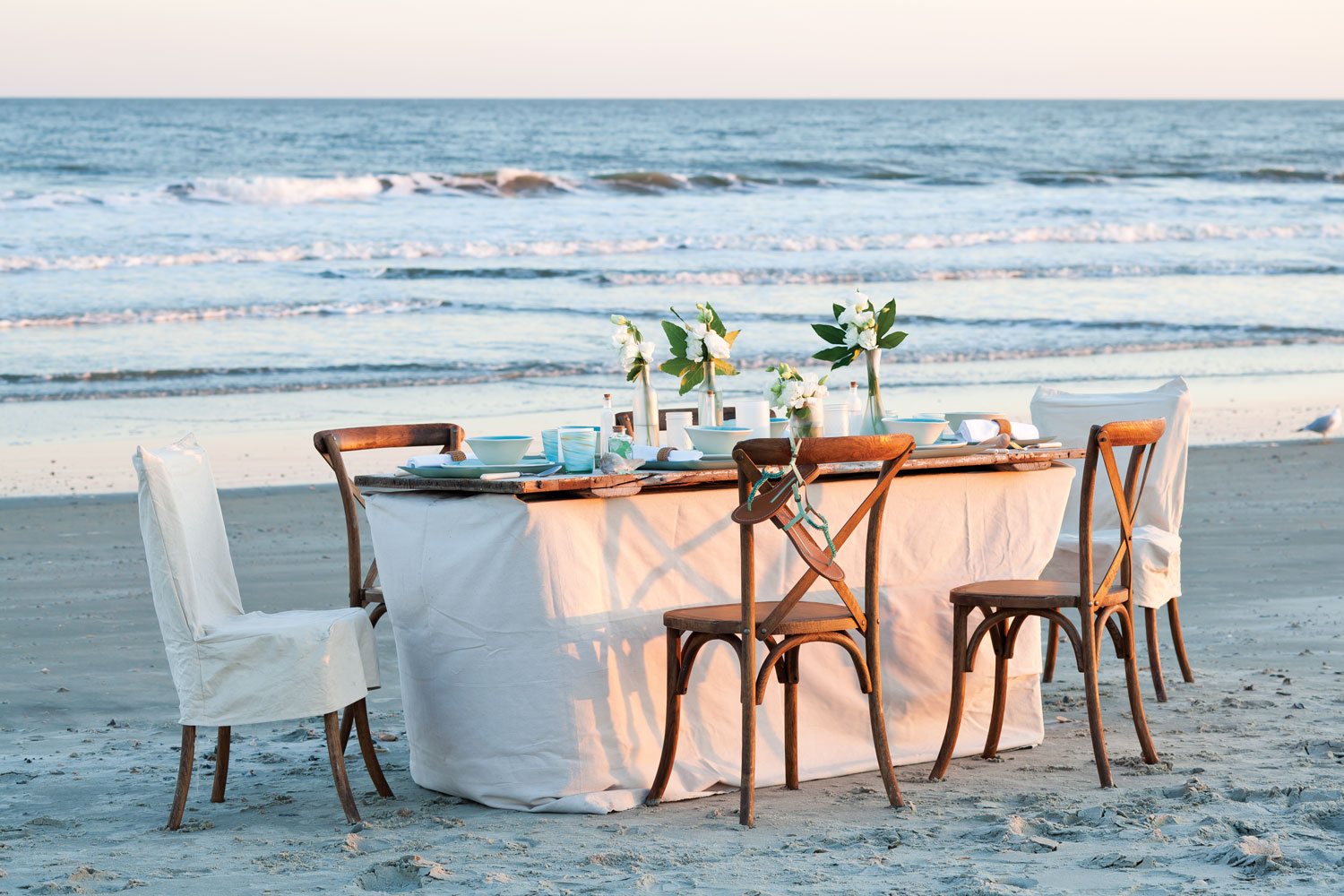 A picture of a table setting inspired by the sea on the beach