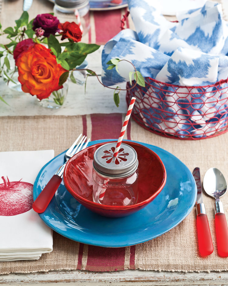 A photo of a red and white table setting