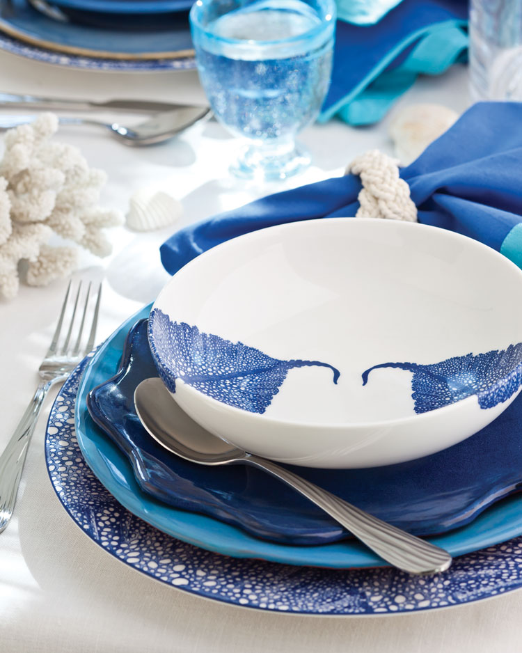 A photo of a blue and white table setting