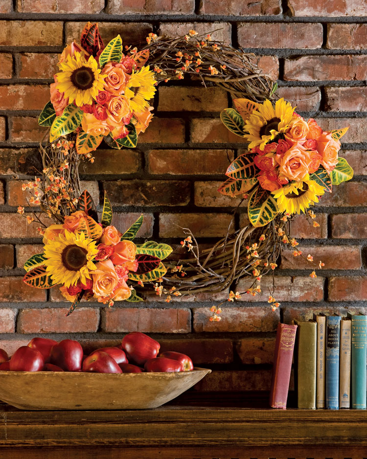 A photo of a grapevine wreath with sunflowers and fall flowers