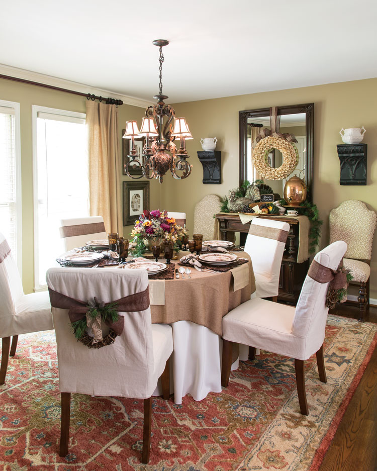 A picture of a dining room set up for a Thanksgiving meal