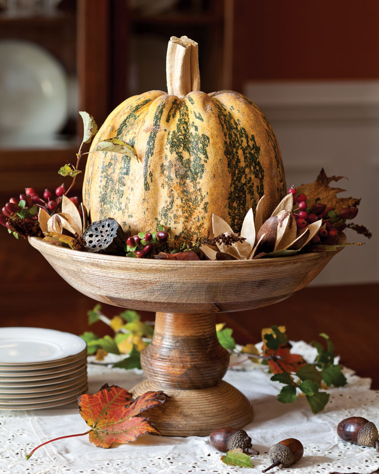 A picture of a pumpkin table centerpiece