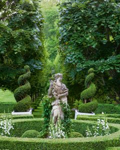 A photo of the statue and grove of trees in the Parterre Garden at Carolyne Roehm's Weatherstone