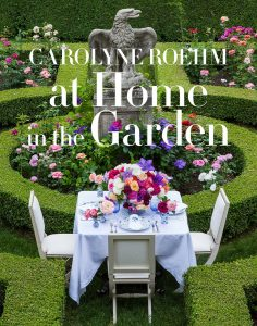 A picture of the cover of At Home in the Garden by Carolyne Roehm