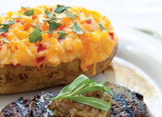 A picture of Filets of Beef with Onion Compound Butter and Pimiento Cheese Twice-Baked Potatoes