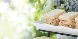A picture of Pimiento Cheese tea sandwiches on the front porch