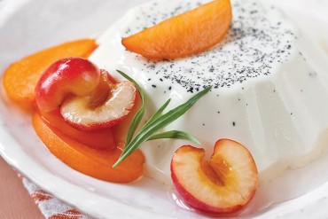 Vanilla Bean Panna Cotta with Apricot, Cherry, and Tarragon Syrup