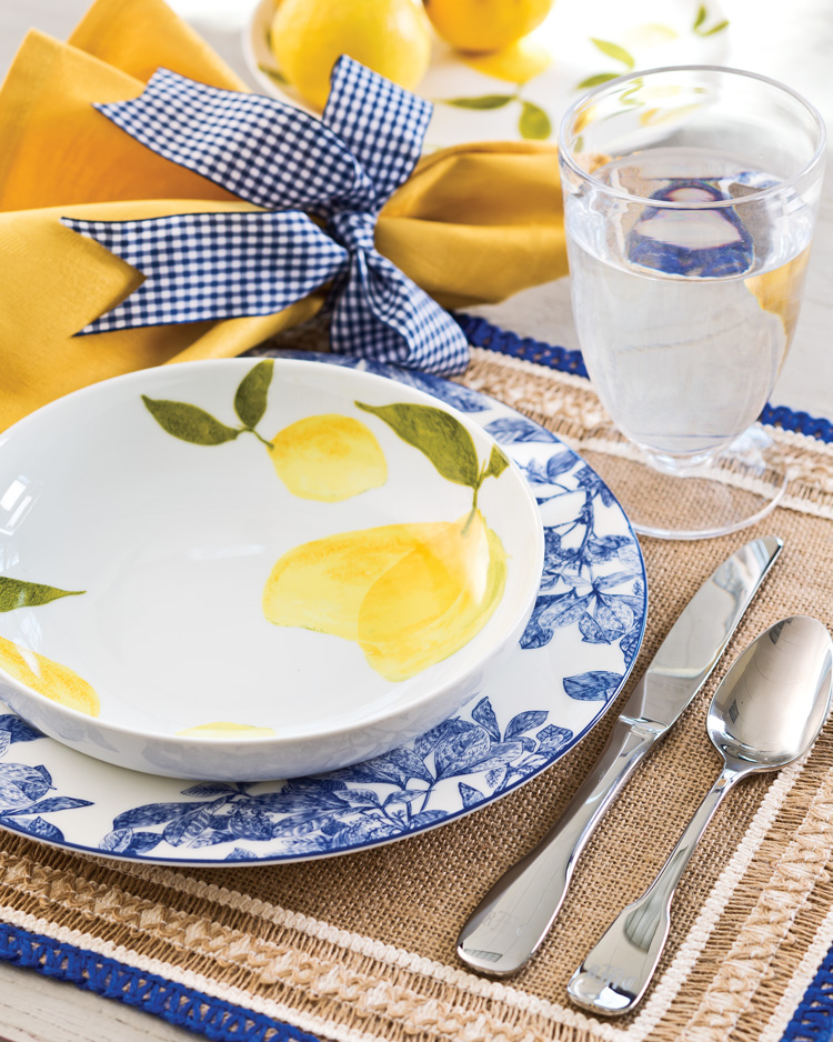 A picture of a blue and white table setting