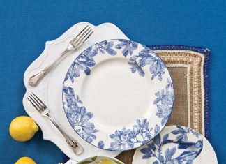 A picture of pieces for two blue and white table settings
