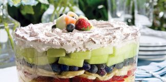 A horizontal picture of seven layer fruit salad