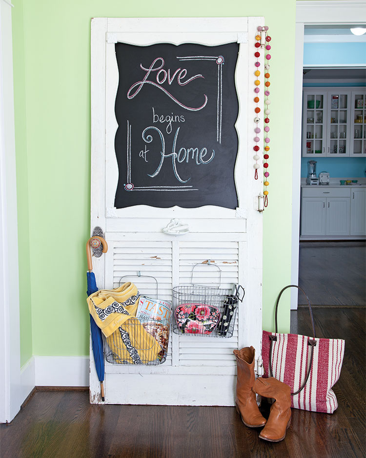 A photo of a screen door repurposed as hall organizer