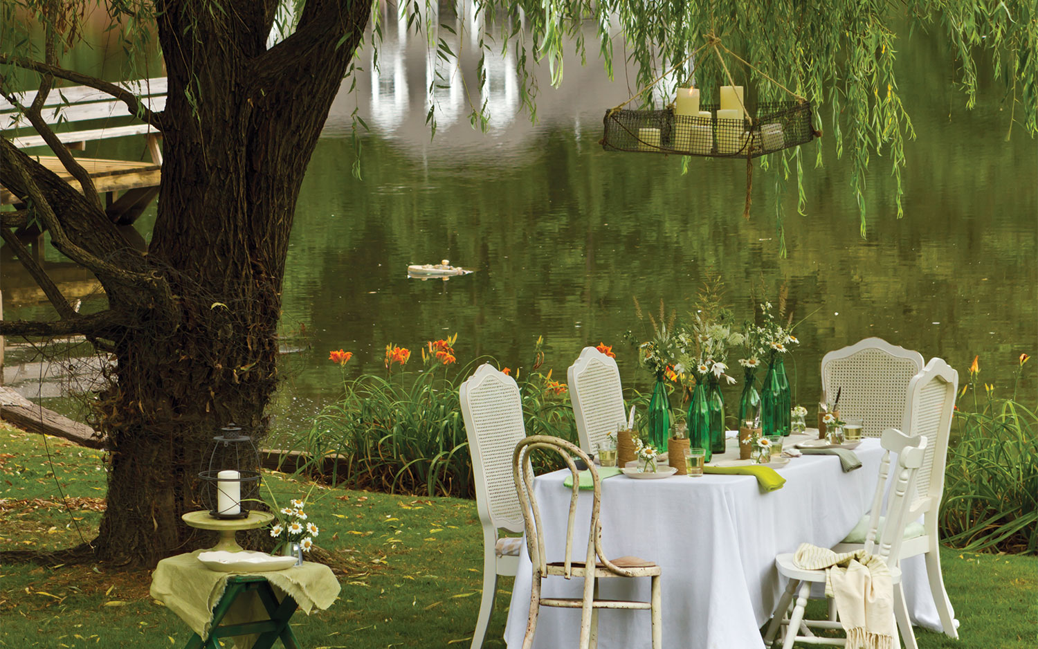 A picture for summer lights for outdoor dining with fishing basket holding candles
